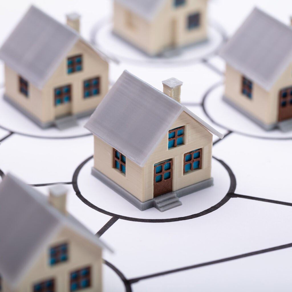 a bunch of tiny model houses in circle outlines